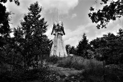 Industrial Transmitter In The Forest. This signal tower looms almost like a space craft from another planet in the heart of this forest. Scene in black and white royalty free stock photos