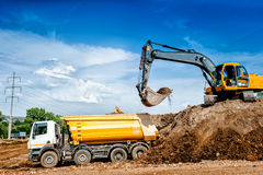 Industrial truck loader excavator and bulldozer moving earth Stock Image