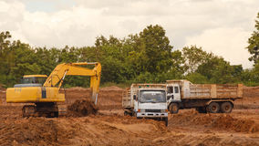 Industrial truck loader excavator moving earth and unloading int Stock Photography