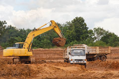 Industrial truck loader excavator moving earth and unloading int Royalty Free Stock Image