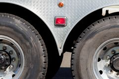 Industrial truck trailer axle tires and wheels. In sunlight royalty free stock photography