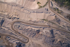 Industrial trucks moves along the road in the sand quarry Royalty Free Stock Photos