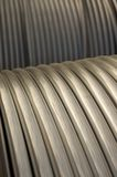 Industrial tubing. Rolls of metal silver tubing or conduit Royalty Free Stock Image