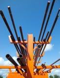 Industrial tubular pipes on storage rack Stock Photos