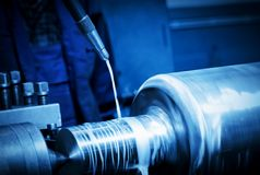 Industrial turning machine at work close-up Stock Photos