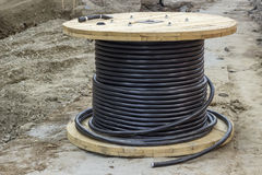 Industrial underground cable on large wooden reel Royalty Free Stock Image