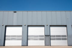 Industrial unit. With roller shutter doors Stock Photography