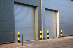 Industrial Unit. Detail of steel roller-shutter doors on a new industrial unit Royalty Free Stock Photo