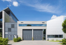 Industrial unit. Modern industrial unit with roller doors Stock Photo