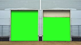 Industrial Unit with roller shutter doors. Warehouse storage doors with green screen mate background are closing. Stock Photo