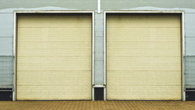 Industrial Unit with roller shutter doors. Warehouse storage doors. Royalty Free Stock Image