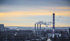 Industrial urban area landscape. Power station with pipes of which poured smoke. Royalty Free Stock Image