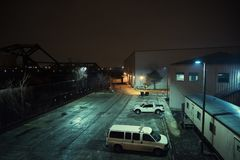 Industrial urban city night scenery. Industrial urban city night scenery in Chicago with warehouses, van, pickup truck, and a vintage bridge royalty free stock photography