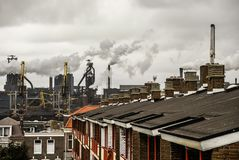 An industrial urban scenery. There are houses` roofs with chimne royalty free stock photos