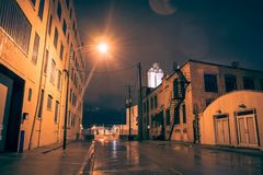 Industrial urban street city night scenery in Chicago. With vintage warehouses and factories after a rain Royalty Free Stock Photo