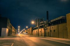 Industrial urban street city night scenery. In Chicago with a vintage factory Stock Photography