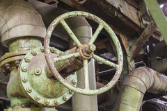 Industrial valve in an abandoned factory Royalty Free Stock Photos