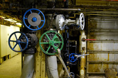 Industrial Valve Wheel. Green and Blue Valve wheels to pumps in factory with wrenches and levers Stock Photography