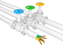 Industrial valves on pipelines and electrocable Stock Photos