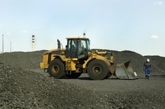 Industrial Vehicle. Earthmoving vehicle loading coal at an industrial site royalty free stock photography
