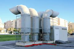 Industrial Ventilation. Detailed view of an Industrial ventilation system with big outlets on a residential area Royalty Free Stock Image