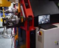 Vertical steel round bending machine stock photos