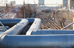 Industrial view with pipeline and railway lines Royalty Free Stock Photography