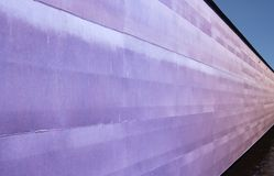 Industrial violet structure. Colorful industrial view of outgoing huge steel wall. Industrial violet structure. Colorful industrial view of outgoing steel wall stock image