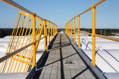 Industrial Walkway. Walkway with access ladder over fuel storage facility Royalty Free Stock Photos