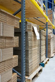 Industrial warehouse. Interior and shelves with packaging cardboard Royalty Free Stock Photography