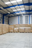 Industrial warehouse. Interior with pallets of cardboard cartons Royalty Free Stock Photography