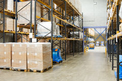 Industrial warehouse. Interior with pallets of cardboard cartons Royalty Free Stock Photos