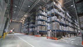 Industrial warehouse with boxes. Forklift Small cargo truck drives to warehouse. Large warehouse logistics terminal stock video footage