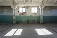 Industrial warehouse with cement walls, floors, windows and pillars before construction, remodeling, renovation stock photo
