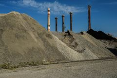 Industrial warehouse of raw materials for cement production and Royalty Free Stock Photography
