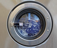 Industrial washing machine. Photo of an industrial washing machine with a full load of clothes Stock Image