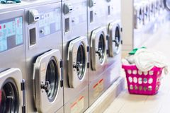 Laundromat. Industrial washing machines in a public laundromat royalty free stock photos