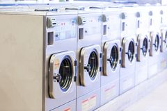 Laundromat. Industrial washing machines in a public laundromat stock photo