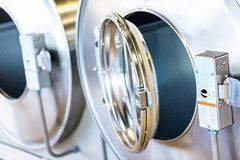 Laundromat. Industrial washing machines in a public laundromat royalty free stock photography