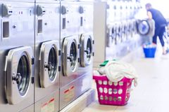Laundromat. Industrial washing machines in a public laundromat stock photos