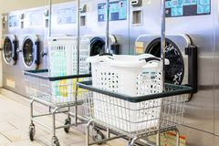 Laundromat. Industrial washing machines in a public laundromat royalty free stock image
