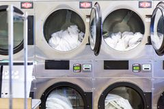 Laundromat. Industrial washing machines in a public laundromat stock photography