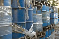 Industrial waste barrels. Industrial waste tanks left outside in nature Royalty Free Stock Photo