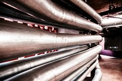 Industrial water pipelines inside building, metal pipes close up royalty free stock image