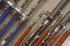 Industrial water pipes and tubes. For water transmission Royalty Free Stock Photos