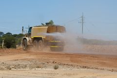 Industrial Water Truck. On Dirt Road Royalty Free Stock Photo