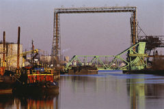 Industrial waterway. Ship on industrial waterway at sunset Stock Photo