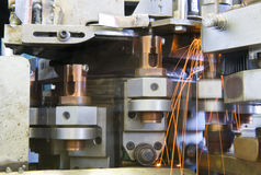 Industrial welding machinery at work, in motion. Royalty Free Stock Photography