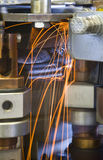 Industrial welding machinery at work, in motion. Royalty Free Stock Photos