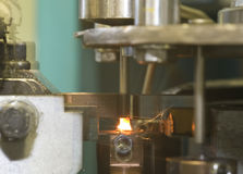 Industrial welding machinery at work, in motion. This machine is making screws Stock Photo